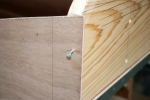 10. Tack upper corners of transom with deck screws until nailing.