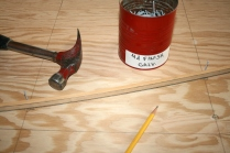 11. Use finishing nails to spring batten along interior lines.