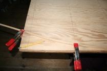 12. Draw lines along batten.