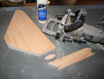 22. I fastened strut to stem with biscuit joiner; then glued and screwed to box.