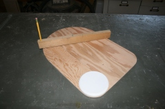 23. Use beam compass and lid to lay out headrest.