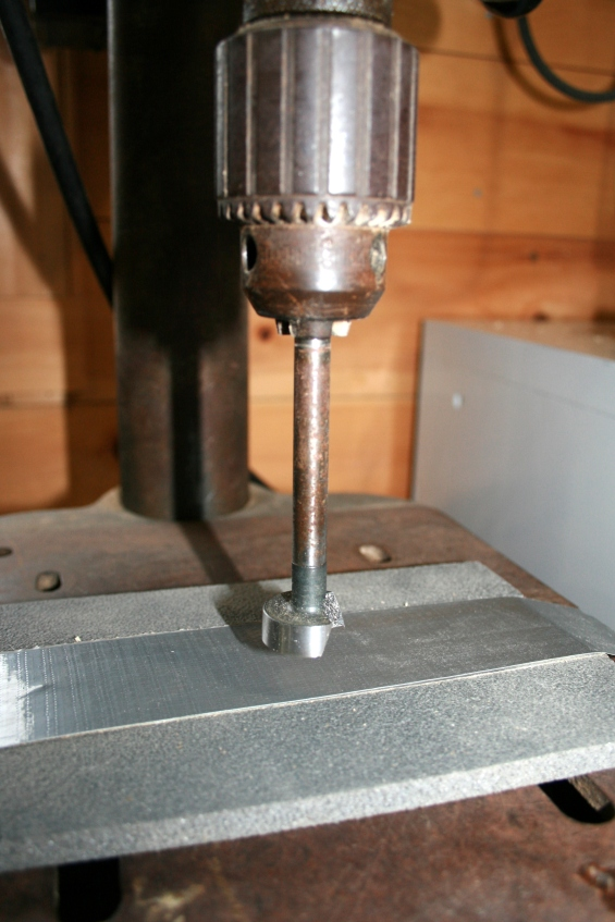 "24. Pad the table and set the drill press depth to about 1/2 "" - with a 1"" Forstner bit."