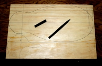 3. Draw the pattern outline on stock thick enough for head - this is 3-inch sugar pine. Make sure grain runs through the bill so it will resist breaking in use.