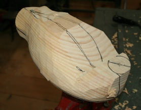 32. Screw the hardwood cleat to the body and put her in the vise. Start shaping the body with the drawknife.