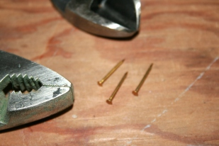 49. To keep the body halves from sliding during glue-up, I use 3 solid brass escutcheon pins..