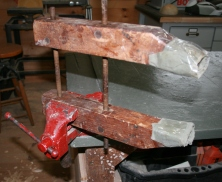 54. I use a single padded wood clamp held in my vise. The padding is wrapped with cellophane tape so epoxy will not stick.