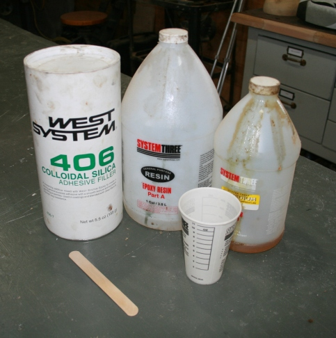 55. I use a marine epoxy thickened with colloidal silica (Cabosil).