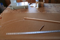 7. Laying out canvas with battens, straightedges and chalk.