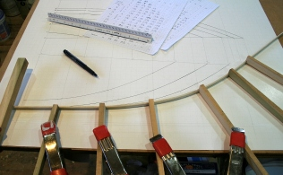 2 - Measuring above and below the sheer line I mark every 4 inches and then bend and clamp a spline to the marks.