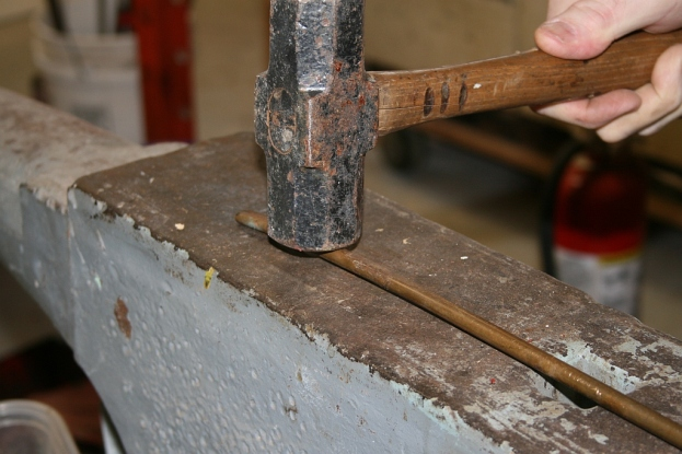 "1 - First we hammered the 3/8"" bronze rod flat on 2 sides - to ease the bending."