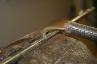 3 - The middle was bent around a piece of solid steel rod.