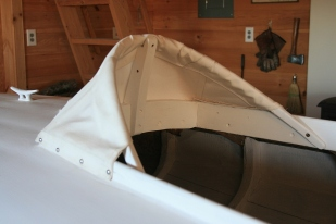 3 - I fastened the canvas to the coamings with SS panhead screws.