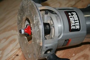 "After cutting most of the excess off with a sabre saw, I use a 3/8"" round-over bit in a router to get the final edge."