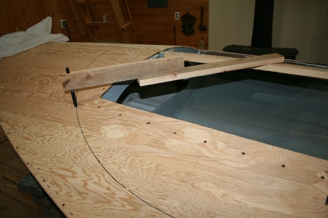 "While the king plank is still in place, I scribe the radius for a ""toe rail"" to hold the lower edge of the cowling."