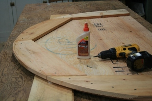 Softwood is glued and screwed to top and bottom of plywood to take fasteners and allow for beveling.