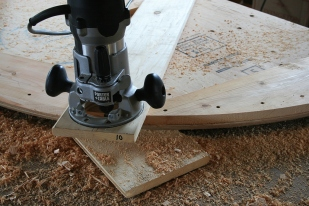 About 3 passes are made - each one a bit deeper - with a straight-cut bit in the router.