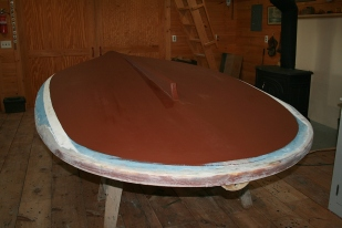 No - it's not real copper bottom paint on a winter boat. It's just red primer - because I had it on hand and because it looks traditional.