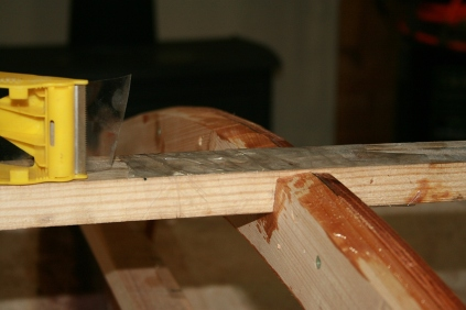 The king plank is taped so it is not prematurely glued to bulkheads.