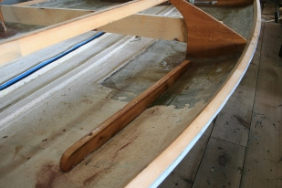 "Shelf fiddles are screwed right through hull - to ""clamp"" them until epoxy cures."