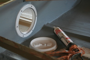 The 6-inch Beckson deck plates are set in a silicon caulk.
