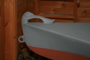 The bronze bow eye also serves as the fairlead for the painter/anchor rode.