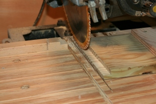 The end coamings are rabbeted to protect the end grain of the side coamings.