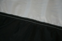 3 - The middle seams are not lapped-felled - just two seams, one close to the raw edge.