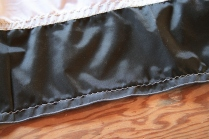 5 - All outside edges are hemmed and the raw edge is zig-zag stitched.