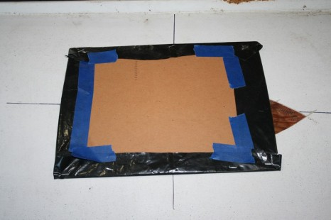 """11 - Heavy cardboard with poly covering backed up the first big fill. The epoxy included 1/2"""" 'glass fibers for some structural integrity."""