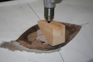 13 - This jig helped to guide the drill vertically through the deck and the new chock behind it.