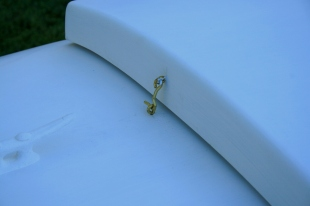 7 - Brass hooks&eyes will keep the hatch on - at least when it's in storage.