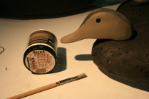 Behr Mocha Accent from Homre Depot - in a sample-sized jar - is a good base color for the face on a Black Duck.