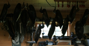 I hang the birds so the varnish will run to one spot - the tail.