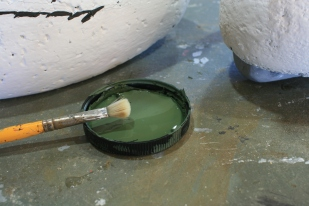 19 - Once the base dried, I used a beat up #10 Filbert brush to stipple on the Pastoral along the aft edges of the face.